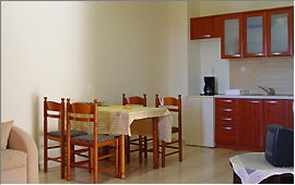 Apartment - dining table and kitchenette